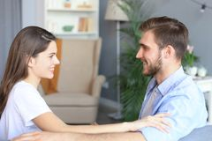 Free Side View Of A Couple Talking Sitting On A Couch And Looking Each Other At Home Royalty Free Stock Images - 145563949