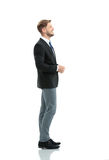 Side View Of A Smiling Businessman Standing , On White Backgroun Stock Image