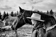 Free Side View Of A Young Horse Woman And Her Horse Royalty Free Stock Photography - 105203217