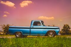 Free Side View Of An Old Classic Car On The Street. Retro Style Photo Of An American Oldtimer Pick-up From The 1960`s. Vintage USA Royalty Free Stock Images - 191828839