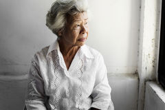 Free Side View Of Elderly Asian Woman With Thoughtful Face Expression Stock Photography - 99196532