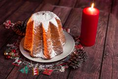 Free Side View Of Italian Pandoro Cake With Warm Light, Christmas Decorations, Candles, Pine Cones, Close Up With Warm Light Giving A Stock Images - 163952214