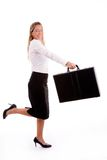 Side View Of Smiling Employee Holding Briefcase Stock Image