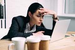 Free Side View Of Tired Businesswoman Royalty Free Stock Photography - 127727667