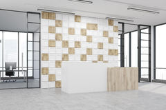 Side view of an office lobby with tiled white and wooden wall Royalty Free Stock Image