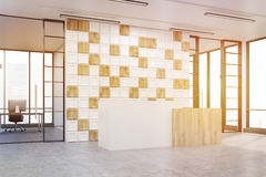 Side view of an office lobby with tiled white and wooden wall, t Stock Image