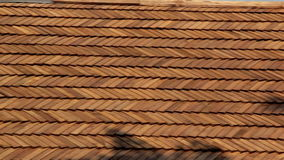 Side view of the oiled cedar wooden shingle roof of the log house shake stock video