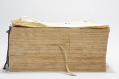 Side view of old book with yellow pages Stock Photography
