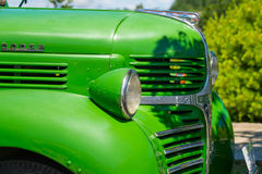 Side view of old Dodge truck. Side view of the front section of an old green Dodge truck royalty free stock photos