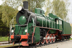 Side view of old green, steam locomotive Stock Image
