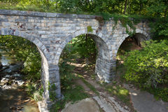 Side view of old stone bridge built in 1874. Off of route 66 in Virginia Stock Image