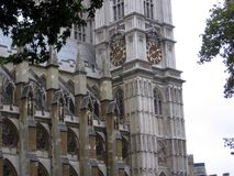 Side view of the old tower clock of Westminster Abbey London United Kingdom. Europe Stock Images