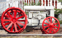 Side view of old tractor with red wheels Royalty Free Stock Photography