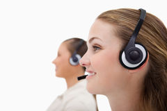 Side view of operators using headsets Stock Photography