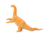 Side view orange diplodocus toy. On a white background Royalty Free Stock Photography