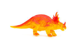 Side view orange triceratops toy on white. Side view orange triceratops toy on a white background Royalty Free Stock Photo