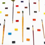Side view paint brushes and watercolors on white Royalty Free Stock Photos