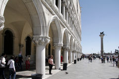 Side view of Palazzo Ducale, Venice, Italy. Side view of the Palazzo Ducale, Venice, Italy with women in front Royalty Free Stock Photos