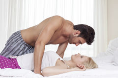 Side view of passionate young couple in bed Royalty Free Stock Images