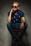 Side view of a pensive fashion blond male model Royalty Free Stock Photo