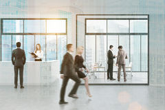 Side view of people walking past reception, city royalty free stock photo