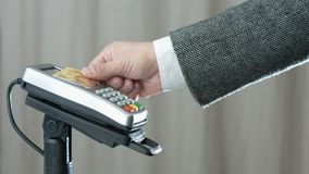 Contactless payment with credit card. Side view of person using contactless payment with credit card stock video