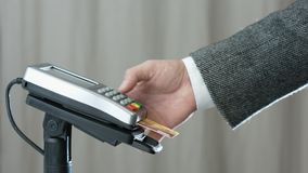 Contactless payment with credit card. Side view of person using contactless payment with credit card stock video footage