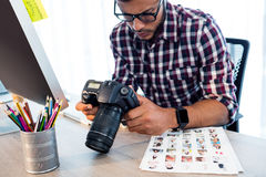 Side view of photographer working at desk Royalty Free Stock Images