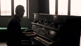 Side view. Pianist playing the vintage piano in old-fashioned interior. stock video footage