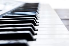 Side view of piano keys. Close-up of piano keys. Close frontal view. Piano keyboard with selective focus. Diagonal view. Piano key. Board perspective royalty free stock photography