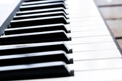 Side view of piano keys. Close-up of piano keys. Close frontal view. Piano keyboard with selective focus. Diagonal view. Piano key. Board perspective royalty free stock photo