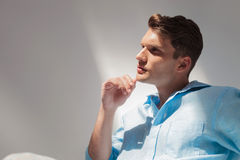 Side view picture of a thinking young casual man Stock Photography