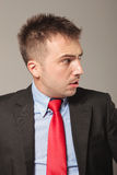 Side view picture of a young business man making Royalty Free Stock Photography