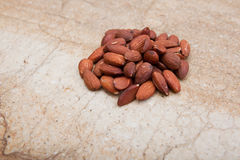 Side view of a pile of almonds Royalty Free Stock Photos