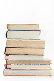 Side view of a pile of books.  royalty free stock photo