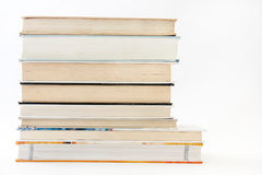 Side view of a pile of books.  stock images