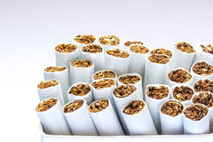 Side view  pile a cigarettes Royalty Free Stock Photos