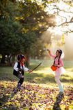 Side view of playful siblings wearing costumes at park Royalty Free Stock Images