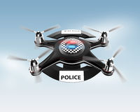 Side view of police drone on blue sky. Stock Photography