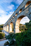 Side view of Pont du Gard and tourists path Stock Images