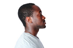 Side view portrait of african man. Over white background Royalty Free Stock Images