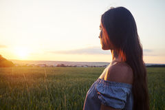 Side view portrait of beautiful dark-haired during sunset Stock Photo