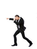 Side view portrait of a businessman punching Stock Photography