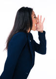 Side view portrait of a businesswoman shouting Stock Photography