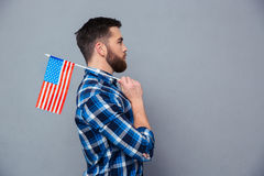 Side view portrait of a casual man holding USA flag Stock Photo