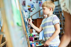 Cute Little Boy Painting Picture stock photography