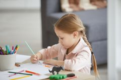 Little Girl Drawing Animals royalty free stock image