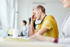 Stressed Young Man at Work stock photo