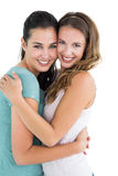 Side view portrait of a female embracing her friend Stock Images
