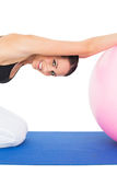 Side view portrait of a fit young exercising with fitness ball Stock Photo